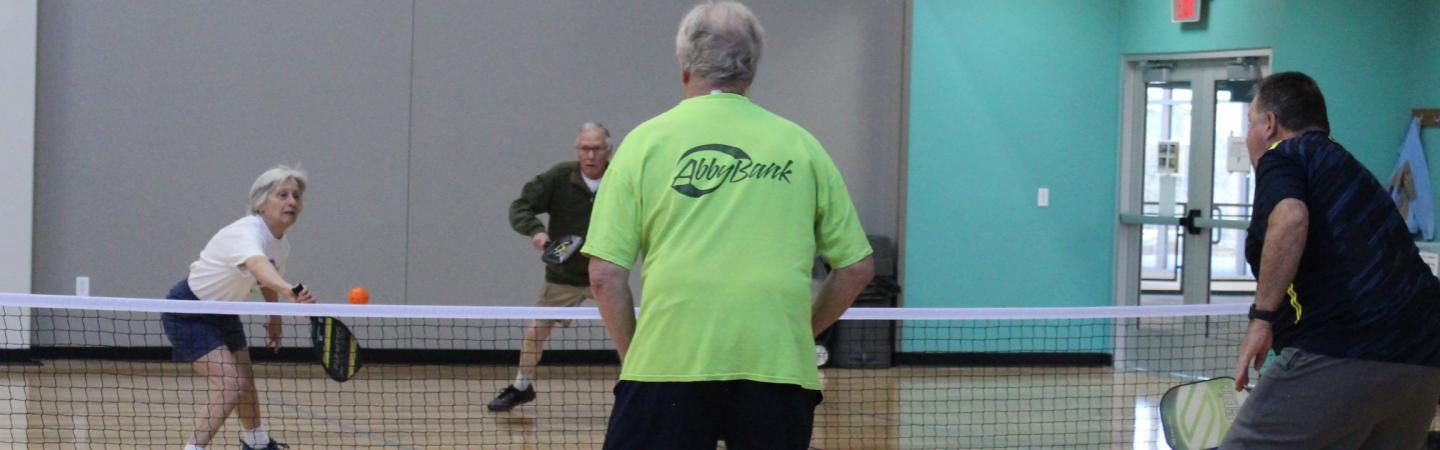 pickleball players in game
